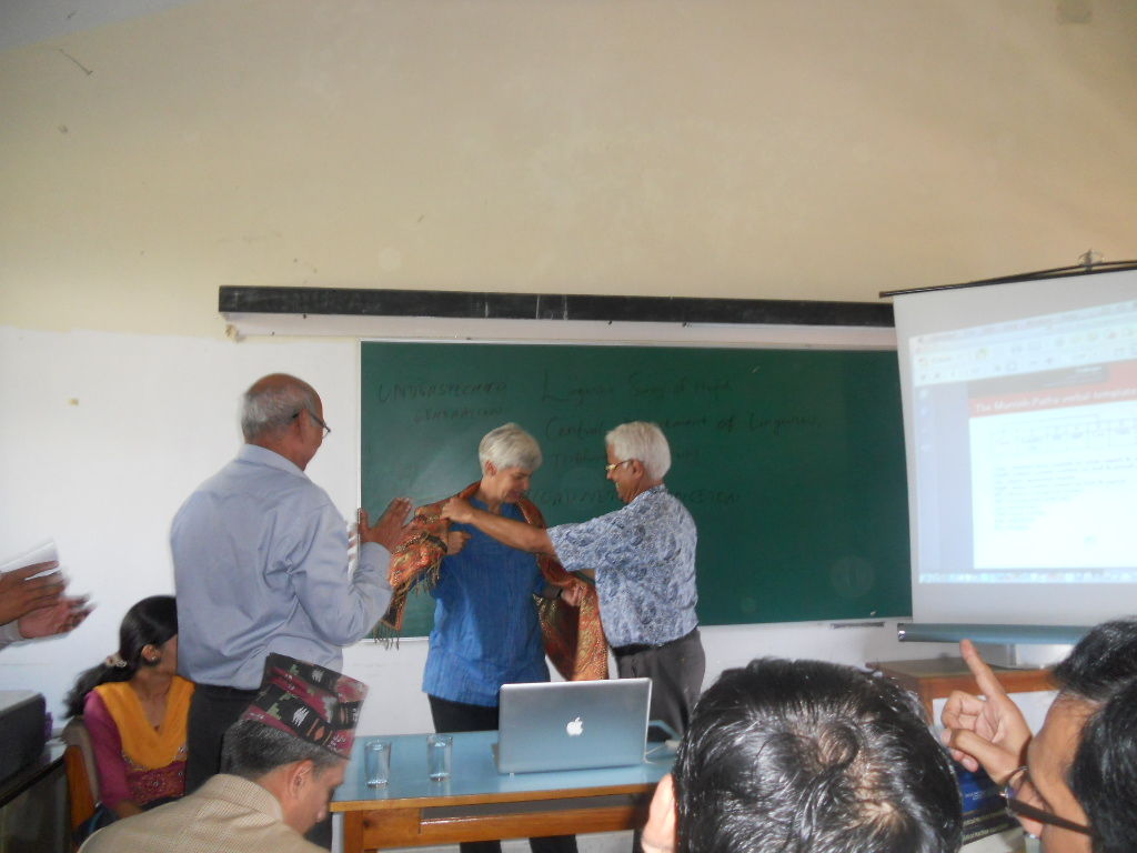 Prof. Dr. Yogendra Prasad Yadava and Prof. Dr. Madhav Prasad Pokharel, former Presidents of LSN offering a shawl to Prof. Dr. Miriam Butt as token of love after she gave a talk jointly organized by LSN and CDL on September 7, 2012